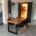 Inneneinrichtung Bootshaus - Massivholztisch Eiche und Schwebetürenschrank als Raumteiler